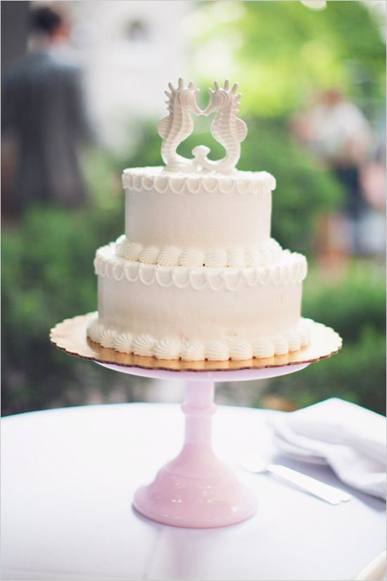 seahorse topped wedding cake #weddingcake #caketopper #weddingchicks http://www.weddingchicks.com/2014/04/11/pink-party-wedding/