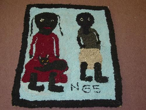 "20TH CENT. FOLKY HOOKED RUG W/ 2 BLACK CHILDREN W/ CAT SIGNED NGS (NANCY G. SCOTT) (36"" X 30"") - WEAR & IMPERFECTIONS;"