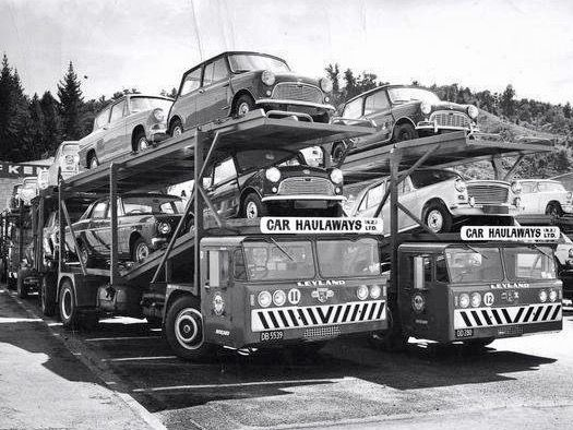 """Bill ✔️ 1960s. Specially built Leyland car transporter truck and trailer units, loaded up with locally assembled """"little British cars""""!   New Zealand.     Bill Gibson-Patmore.  (curation & caption: @BillGP). Bill✔️"""