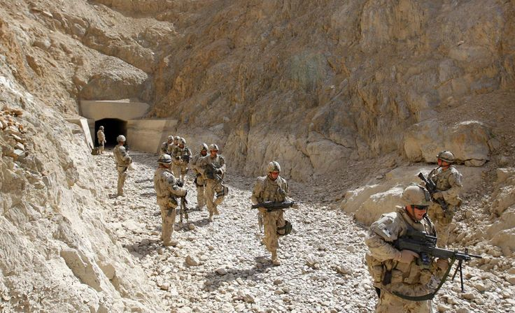 Canadian soldiers from the NATO-led coalition check a dry river in the Taliban stronghold of Arghandab district in Kandahar province, southern Afghanistan, March 12, 2009. (REUTERS/Stefano Rellandini) #