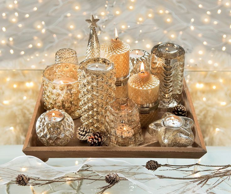 Folosind lumarile, creeaza o atmosfera de vis in casa ta  #kikaromania #decoratiuni #accesorii #iarna #living #emotie #familie #camin #locuinta #argintiu #globuri #jucarii #Craciun #MosCraciun #cadouri #dorinte #SarbatoriIarna
