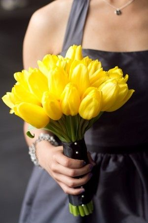 I like the idea of just a few tulips...not a full bouquet...with the bride's cluster just slightly larger.  We can always buy/make a bouquet for throwing....as if I know any single women.