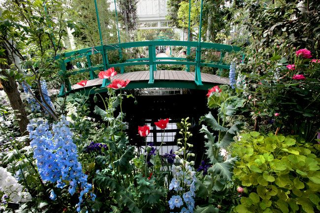 A reproduction of the famous green bridge that arches over the lily pond at Giverny and a re-creation of the Grand Allée can be seen at the New York Botanical Garden's Monet exhibition.