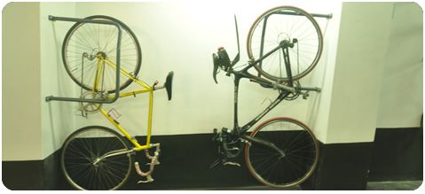 This vertical bicycle rack from Bike Storage allows formerly dead space to be bought to life via cycle parking. The rack allows locking. http://www.bikestorage.com.au/index.php/product/view/27/190