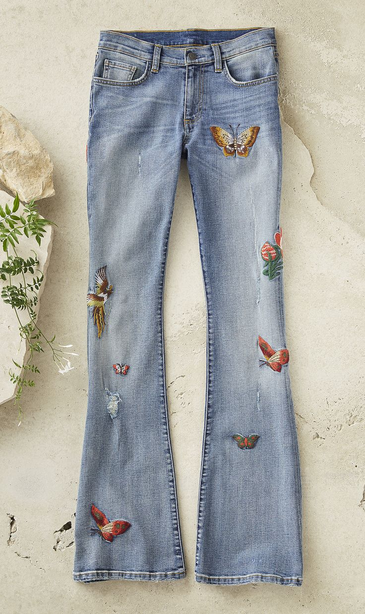 Butterflies Are Free Jeans - whimsical, flared-leg jeans, covered with embroidered butterflies, pheasants and flowers.