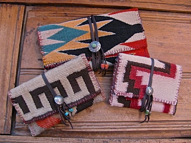 Wallets made from vintage Navajo Rugs that were no longer usable.