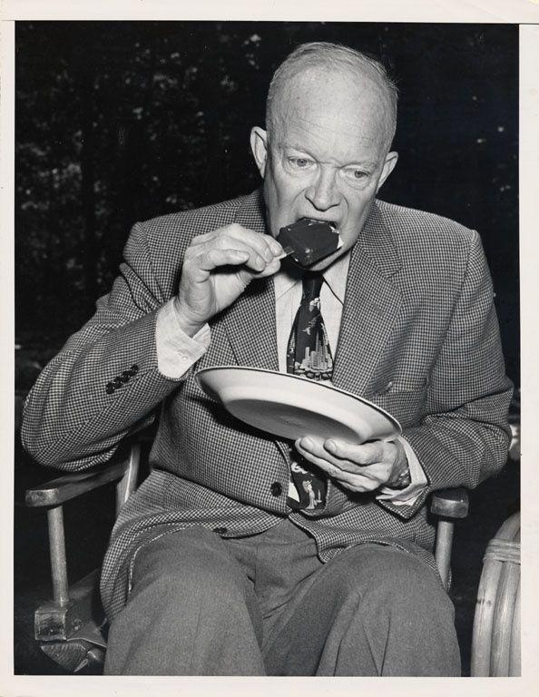 "Indulging in a sweet treat - ""Dwight Eisenhower Eating an Ice Cream Bar,"" 1950…"