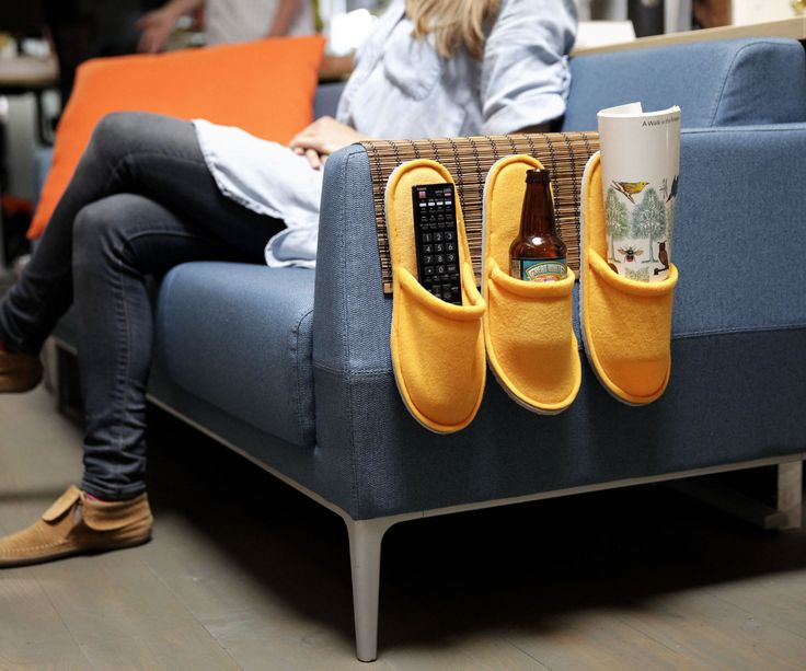 Never lose the remote again! This couch caddy wrangles your remote, magazines, and other couch goodies in vertical storage hanging from the arm of you...