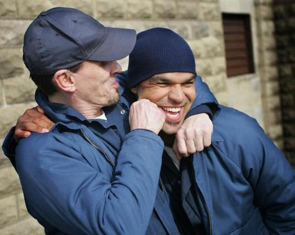 Robert Knepper (T-Bag) and Amaury Nolasco (Sucre) on the set of Prison Break.