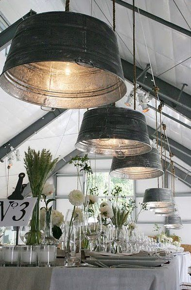 Old metal tubs used as hanging light shades.  One of these would be pretty fab for an outdoor space.