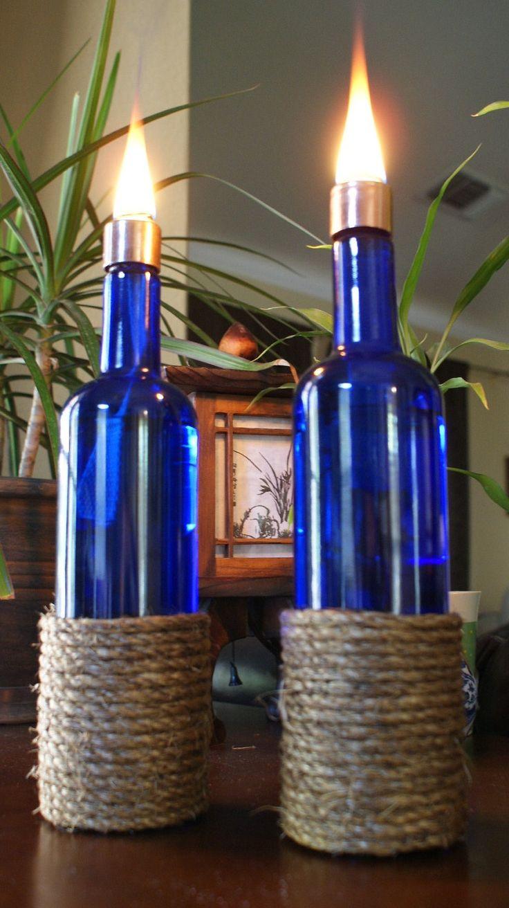 Set of 2  INDOOR Cobalt Blue Manila Rope Wrapped Oil Lamp Bottle-Hurricane Lantern, Indoor Lighting, Oil lamp, Oil Lantern, Tiki Torch. $28.00, via Etsy.