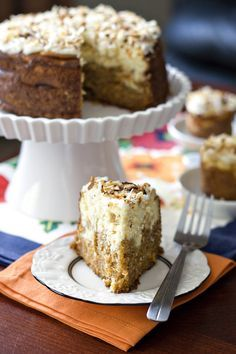carrot cake cheesecake - If your favorite part of a carrot cake is the cream cheese frosting (myself included), then you're going to love this cake because we've added an entire layer of cream cheese flavor with the cheesecake and also loaded some more on top just for good measure.  The spicy carrot cake is perfect with tangy cheesecake and it makes for a beautiful dessert too!