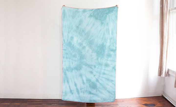 Mint dream throw for Of a Kind. mint & orange