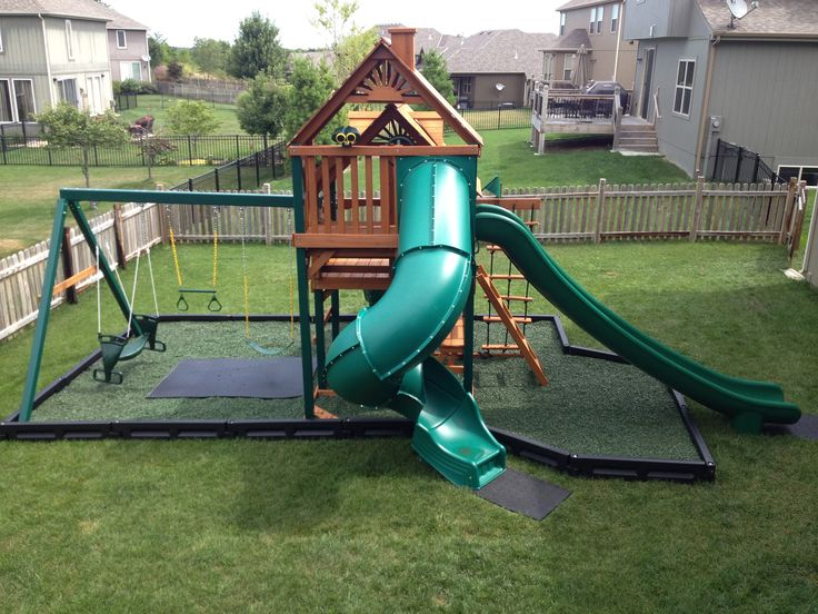 Safe backyard fun.Our green rubber mulch matches the color of grass really well, #swingset #playground #slides #rubbermulch #backyard #kids #borders #RoosterRubber #mats #rubbermats #thinkoutsidethebox