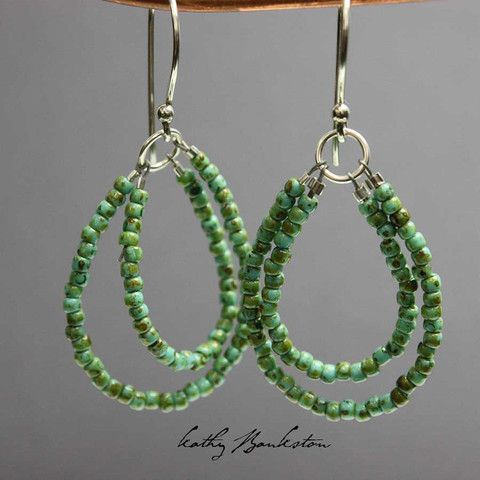 Shiny antiqued turquoise green glass seed bead earrings. This is a very pretty antique turquoise color. Please note these are glass beads, they are not genuine turquoise. These earrings feature too pr