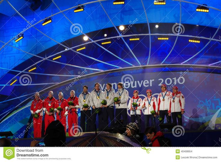 Gold medal ceremony for  Biathlon Men's 4X7.5 km relay during 2010 Winter Olympics competition in Whistler, Canada. Ole Einar Bjoerndalen leads Norway to Gold Medal, Silver Austria, Bronze Russian Federation