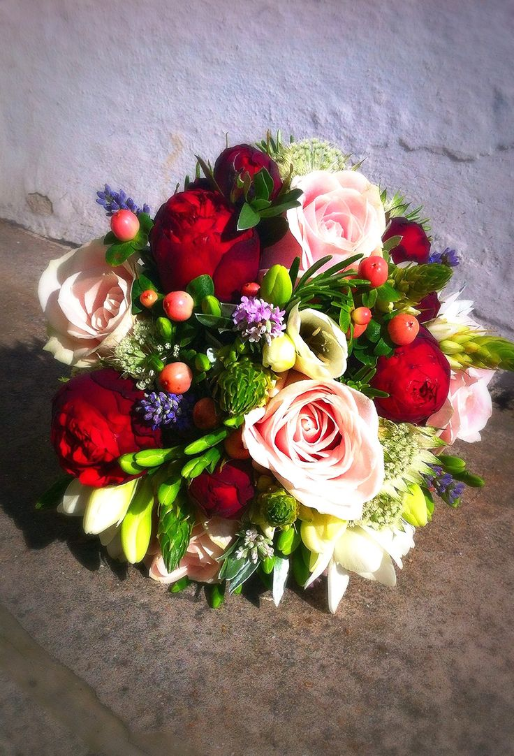 Webb & Farrer bridal bouquet - pale pink, red, lilac and cream flowers clash beautifully together. Roses, ornithogalum, hypericum berries, freesia, lavender and astrantia work together in this textured and delicate bridal bouquet. A sunny Brighton wedding on a hot Summer's day.