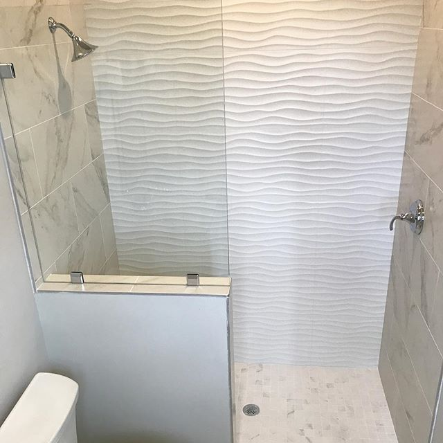 White Wavy Tile Makes For A Fun Summer Inspired Guest Bath