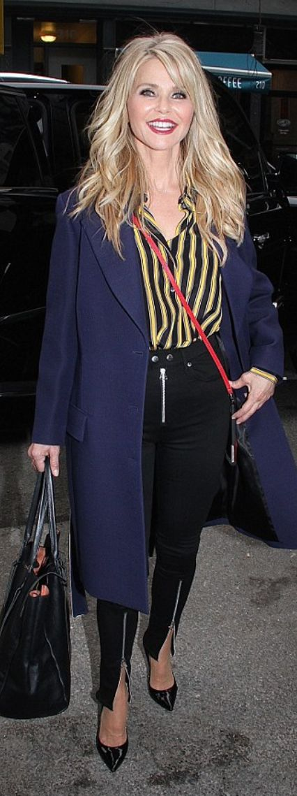 Who made Christie Brinkley's zipper skinny jeans and yellow stripe top?