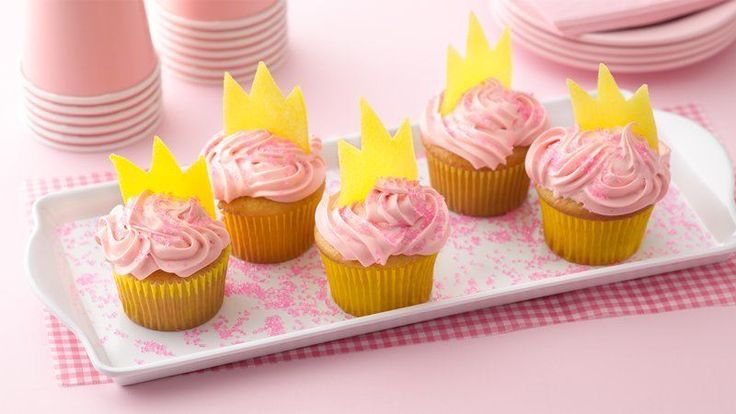 Create cute, edible crown toppers for your princess cupcakes by rolling out sugar-coated gumdrops and cutting them into crown shapes.