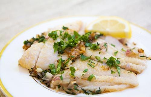 Sautéed Petrale Sole in Herb Butter Sauce ~ Pacific petrale sole fillets, quickly sauteed and served with a sauce of white wine, shallots, butter, and herbs. ~ SimplyRecipes.com