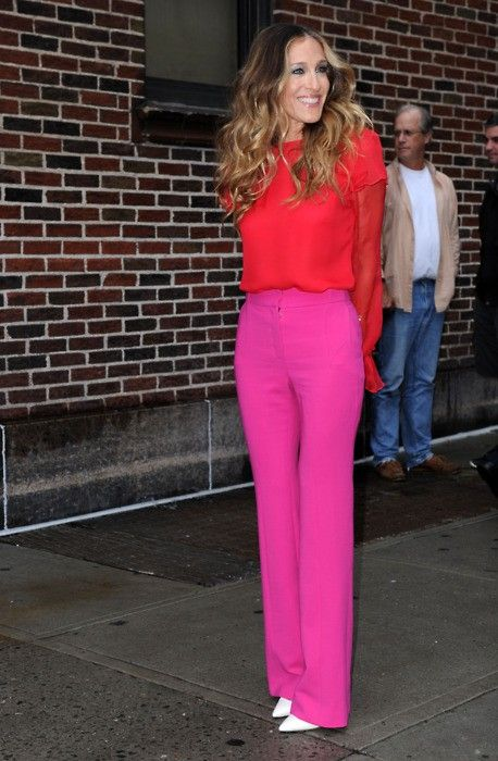 Pink trousers, red blouse.