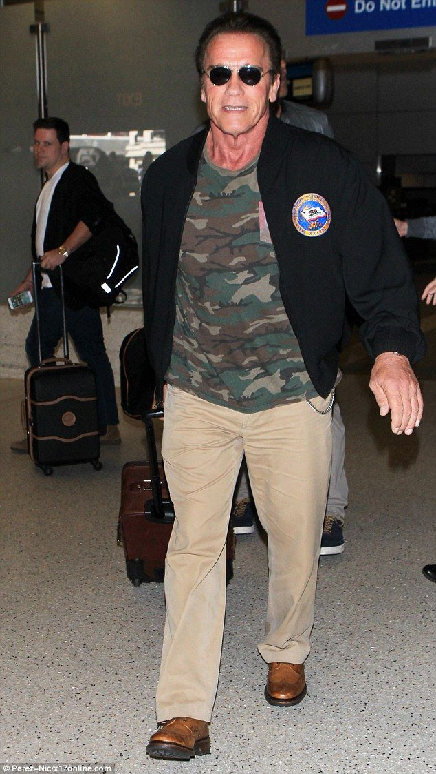 Still married: Arnold Schwarzenegger, pictured arriving at LAX on October 7, has yet to sign the paperwork that will officially end his marriage to Maria Shriver, according to a report Saturday