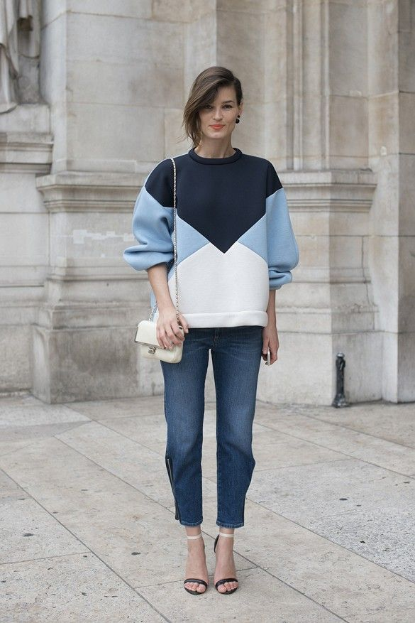 Hanneli Mustaparta wears a colorblocked sweatshirt, cropped zip jeans, and black and white accessories