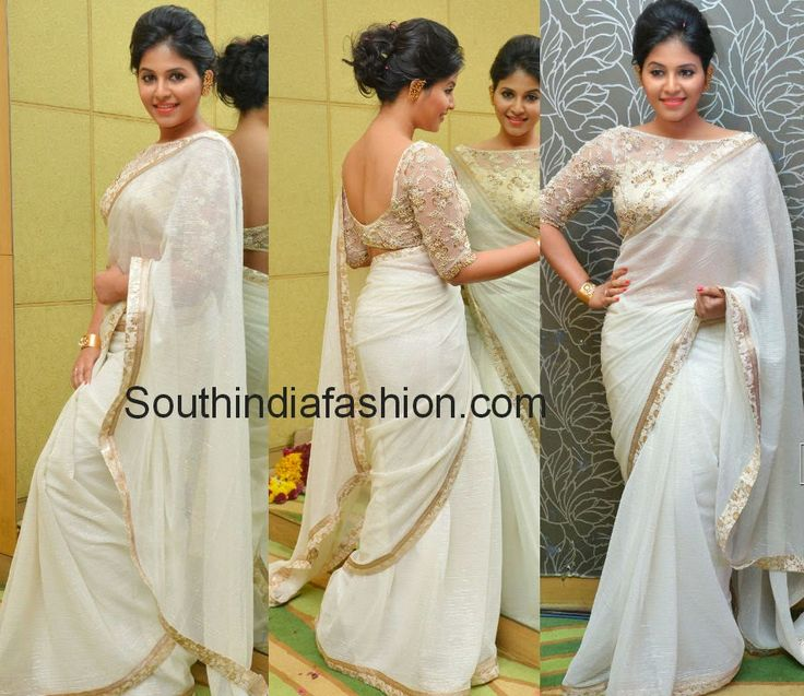 """Actress Anjali sported off white shimmer crushed chiffon plain saree with gold border followed by off white brocade border, teamed up with elbow length sleeves boat neck designer blouse embellished with gold embroidery at """"Geetanjali"""" movie first look launch."""