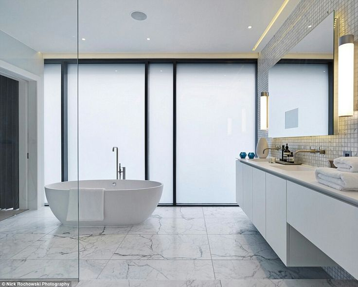 Gallery One The white marble bathroom Over sized tiles and a free standing bath add a touch of cool to the huge space