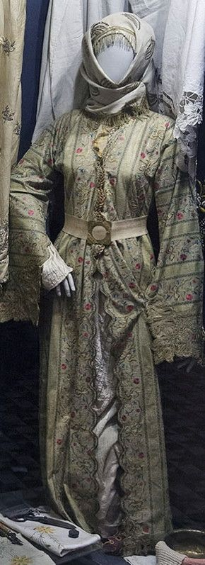 A bridal ensemble with embroidered 'üçetek' (robe with three panels).  Jewish, Istanbul, early 20th century.  On exhibit in the Jewish Museum of Istanbul.