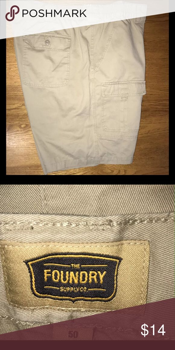 """Men's khaki cargo shorts size 50 Foundry khaki cargo shorts for men size 50. 100% cotton Elastic insets on each side of waist. 2 cargo pockets with flaps, 2 back pocket with flaps.  2 front pockets. Preowned, flawless condition These are made from heavy cotton fabric 24"""" waist side to side 15"""" rise 9"""" inseam 22.5"""" long at side  (my item Foundry Shorts Cargo"""
