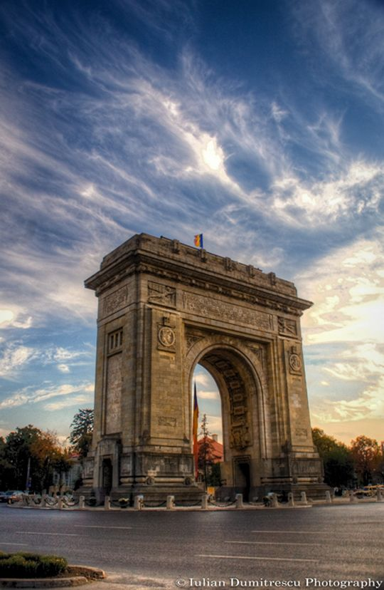 The Triumphal Arch (Arcul de Triumf)  Bucharest, Romania.....ahhhh!!! paris tour rewind please? :(