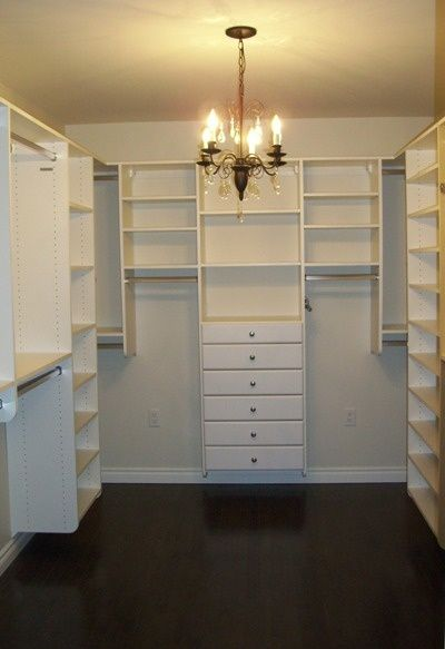 Love all the drawers, sweater, shoe and handbag storage and the clothes bars at different heights.