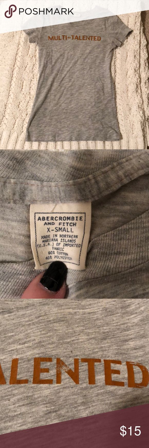 """Abercrombie and Fitch Short sleeve T-shirt Light gray Abercrombie and Fitch T-shirt. Says """"multi-talented"""" on the front in brown letters. Some of the letters are a bit faded but the shirt is in great condition. Worn plenty of times but still like new. Abercrombie & Fitch Tops Tees - Short Sleeve"""