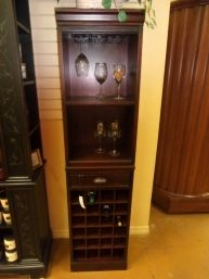 Price: $474.99 Item #: 136803 A stylish alternative to built in cabinetry this mahogany bar tower from Pottery Barn stores and displays all your entertainment needs. The hutch can hold 9 wine glasses from the hanging wine glass rack, the small display shelf beneath is perfect for storing your bottles of alcohol or more glasses, and the wine grid beneath can hold 24 bottles of your favorite wines. The size of this piece is 18W * 14D * 73H.