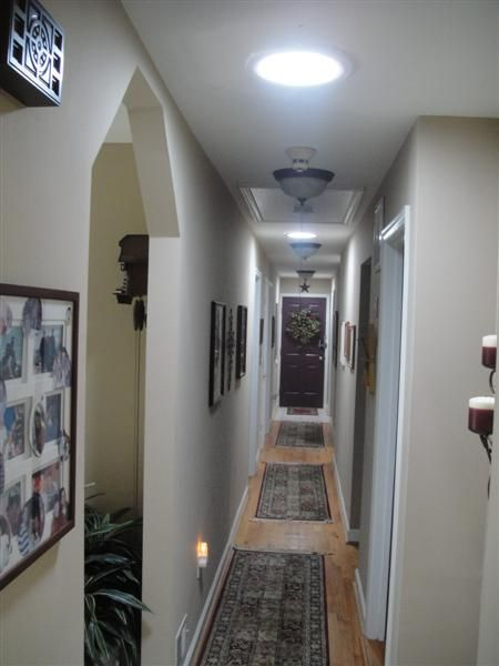 Hallway with Solatube products, the natural light really opens up the space!