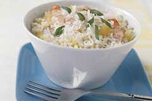 If you like piña coladas and getting folks together for shrimp and rice deliciousness, this 20-minute recipe is the one you've been looking for.