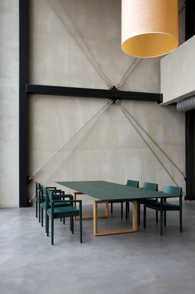 In-Tensive wood frame leg conference table by Inno Interior.
