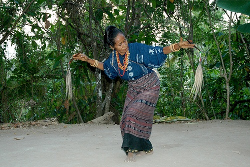 Solo Dance in Watublapi, Flores Island - Indonesia. Flores dances in general are strong in leg movements. The lady is wearing small bells in her legs and ivory bracelets on her arms. She is wearing hand woven Watublapi Ikat on traditional design. The dance is told to be imitating the dance of an eagle high up in the sky surfing the wind.  by Ng Sebastian