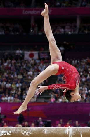 USA's Kayla Ross performs on the balance beam during the women's gymnastic team finals at the London 2012 Olympics on Monday, July 30, 2012 in London.