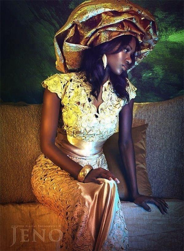 The traditional Yoruba (Nigeria) gele headdress - tops this elegant gold wedding dress.