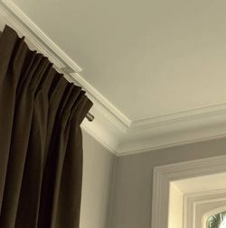 crown molding that creates the illusion of a taller ceiling