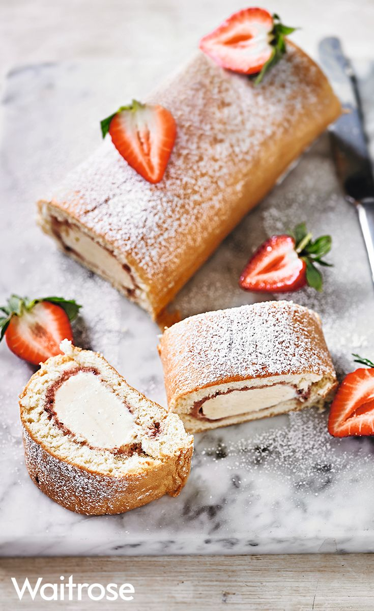 Classic strawberry Artic roll sprinkled with icing sugar and strawberry slices. Find more recipes like this on the Waitrose website.