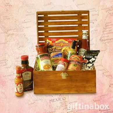 "THE AMERICA'S  Enjoy the ""All American"" tastes from shore to shore in this exquisitve gourmet gift hamper. All treats are lovingly presented in an exquisite wooden crate with hinged lid and filled with wood wool.   All American mustard Tomato ketchup Refried beans Chillies Jalapeno sauce Barbeque marinade Smoked ham Salsa Bisque Soup Corn tortillas Butter popcorn"