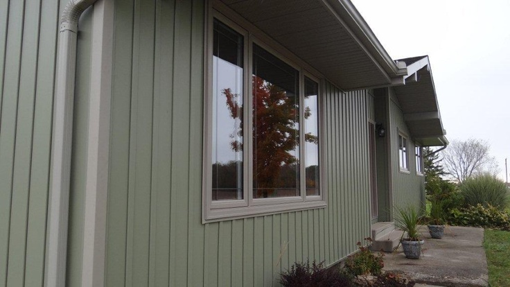 Juniper grove with canyon clay trim vertical siding Vinyl siding vertical