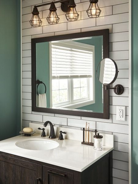 a white subway tile wall provides a distinctive vanity space further highlighted by an industrial light fixture start your bathroom reno with lowes by