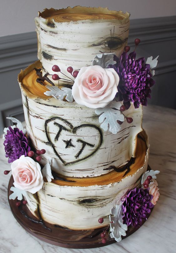 Rustic chic three tier wedding cake accented with pink and purple flowers; Featured Cake: Alliance Bakery