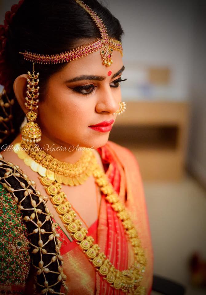 Bridal portraits. Chandini looks ravishing for her muhurtam. Makeup and hairstyle by Vejetha for Swank Studio. Coral lips. Jhumkis. Jhumka. Nose ring. Maang tikka. South Indian bride. Eye makeup. Bridal jewelry. Bridal hair. Silk sari. Bridal Saree Blouse Design. Indian Bridal Makeup. Indian Bride. Gold Jewellery. Statement Blouse. Tamil bride. Telugu bride. Kannada bride. Hindu bride. Malayalee bride. Find us at https://www.facebook.com/SwankStudioBangalore