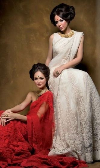 Two women in Saree - Red and White Saree        Sophisticated Yellow Katan Saree with Red Sleeveless Blouse    With Eid and Durga Puja...